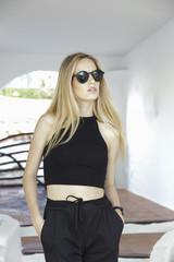 Young beautiful blonde woman wearing sunglasses