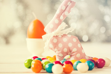 Easter background with colorful eggs on wooden table .