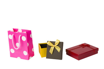 Pink gift packet, red giftbox and yellow brown gift box with ribbon isolated on white