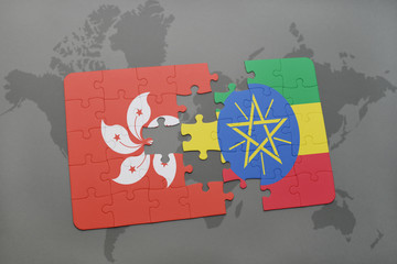 puzzle with the national flag of hong kong and ethiopia on a world map background.