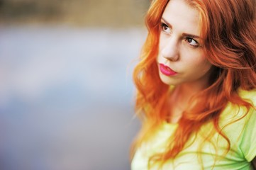 A wonderful portrait of a beautiful red-haired girl with bright