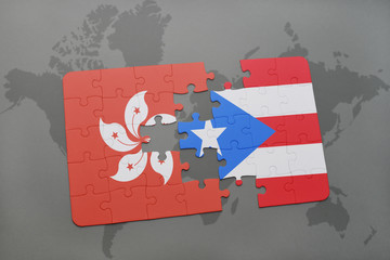puzzle with the national flag of hong kong and puerto rico on a world map background.