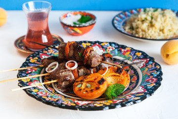 Lamb kebab with dried apricot, bulgur and rose tea