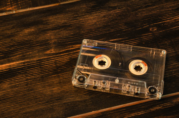 Old audio cassette on wooden background. music abstract.