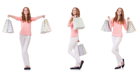 Young woman with shopping bags isolated on white