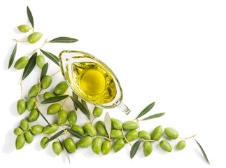 Wall Mural - Raw olives and olive oil, above view.