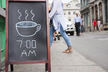Coffee chalkboard sign outside cafe