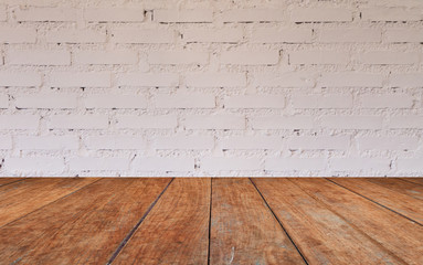 Wooden table top with brick wall