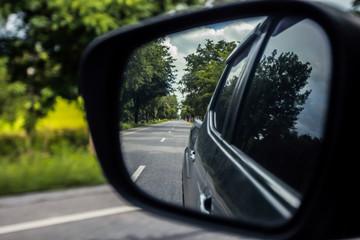 Car side window reflex on the road