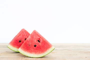 Sliced watermelon on wooden table background.