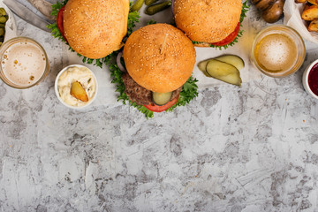 Three fresh homemade different burgers and lager