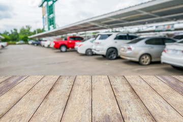wood table top with cars in parking lot