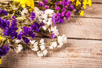 Flowers on wooden background as background