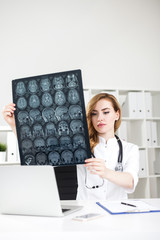 Woman doctor with brain xray
