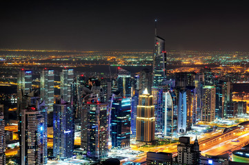 Majestic colorful dubai marina skyline during night. Multiple tallest skyscrapers of the world. Dubai marina, United Arab Emirates.