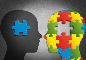 Silueta de cabezas formadas por piezas de puzzle