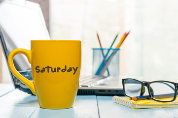 Saturday on morning coffee cup at businessman workplace or office background