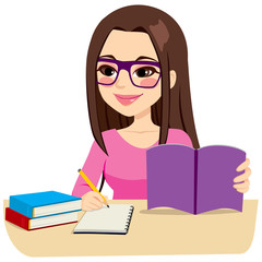 Teenage girl studying with some books and taking notes writing on notebook