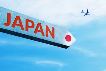 Japan Word on Wooden Painted Sign Board with Airplane and Cloudy