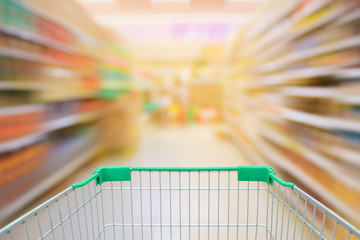 Supermarket motion blur aisle with shopping cart