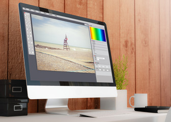 modern workspace with computer photo editor