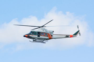 White-orange helicopter is flying