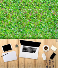 laptop computer with green grass background