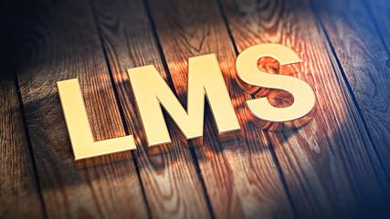 Acronym LMS on wood planks