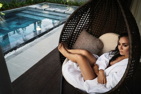 relaxing woman on pool holidays