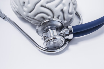 Stethoscope or phonendoscope examine the brain, lying on a white medical the table view from above. Idea for the neurological or neuroscience medical examination or research