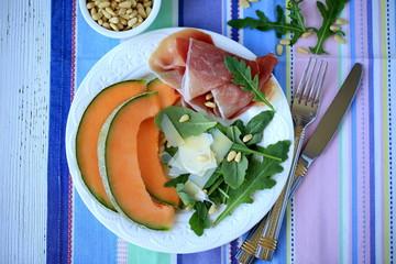 Salad with prosciutto, melon, arugula & pine nuts