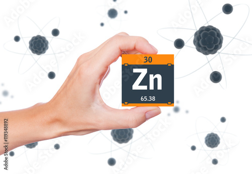 Zinc Element Symbol Handheld And Atoms Floating In Background Stock