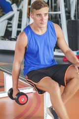 healthy young man exercising with dumbbell