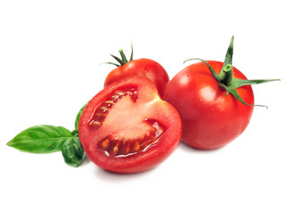 Fresh tomatoes and tomato slice with basil leaves, isolated on white.