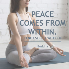 "Attractive young woman working out in loft interior, doing yoga exercise on blue mat, meditating, closeup. Motivational phrase ""Peace comes from within. Do not seek it without"". Buddha"