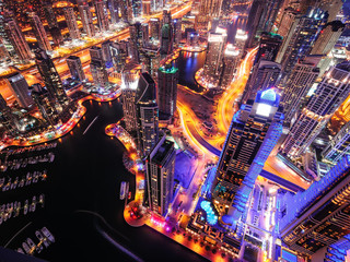 Majestic colorful dubai marina skyline during night. Multiple tallest skyscrapers of the world. Dubai marina, United Arab Emirates.
