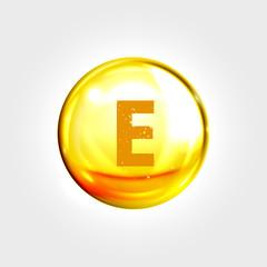 Vitamin E gold icon. Tocopherol pill capsule