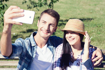 Close up portrait of young attractive couple using smartphone.