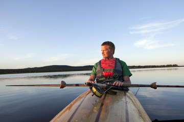 Young man fishing, Sweden