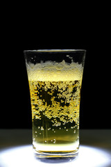 this is Closeup of a glass of fresh foamy beer