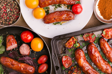 Sausage. Delicious sausages with ingredients. Salad. Spices. Veg
