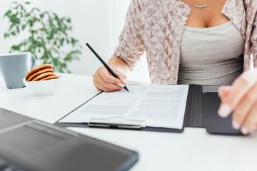 Women writing on notepad