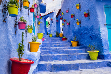 Morocco, Chefchaouen or Chaouen  is most  noted for its small narrow streets and neighborhoods painted in  variety of vivid blue colors. Plantings in colorful pots line the narrow corridors.