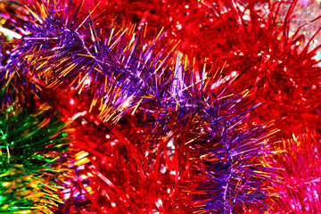 Festive multi-colored background with Christmas tinsel