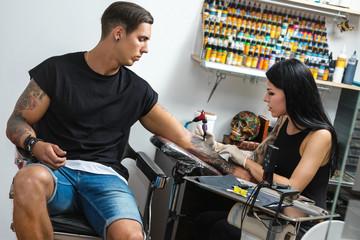 Tattoo artist during her work