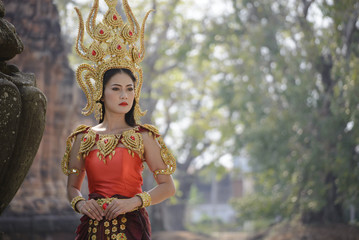 A beautiful woman in dancer apsara costume at stone castle,public place in Thailand