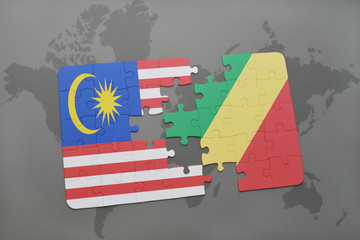 puzzle with the national flag of malaysia and republic of the congo on a world map background.
