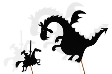 Shadow puppets of dragon and knight and their shades on white background