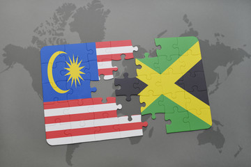 puzzle with the national flag of malaysia and jamaica on a world map background.