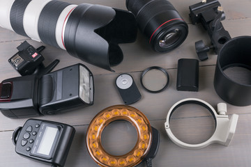camera photo lenses and equipment on wooden background